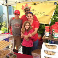 Yandow family selling maple products at a Vermont Farmers Market